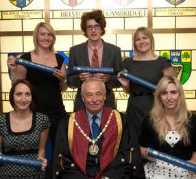 Students from St George's University, Grenada, attend a ceremony at the Royal College of Veterinary Surgeons, London, and are admitted to the college. L-R: Francesca Hendey, Matthew Foulkes, Jennifer Roberts. Front: Caroline Dennis, college president Dr Jerry Davies, Ashley Beresford. Wednesday 7/27/2011. Photograph © Andrew McCargow