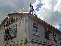 Man on Top of Rood After Hurricane Ivan