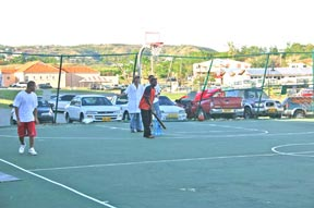 Students on Basketball Court After Hurricane Ivan