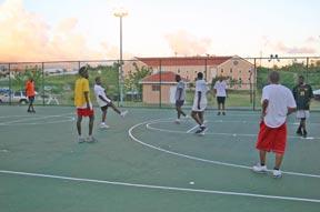 Students on Basketball Court After Hurricane Ivan Yellow shirt
