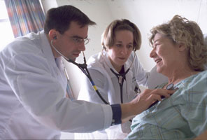 two doctors with patient