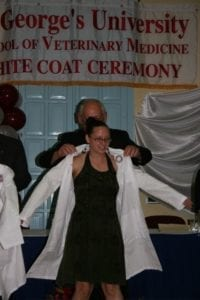 Woman Receiving White Coat at SVM 2006
