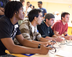 students playing nintento wii olympics 2011