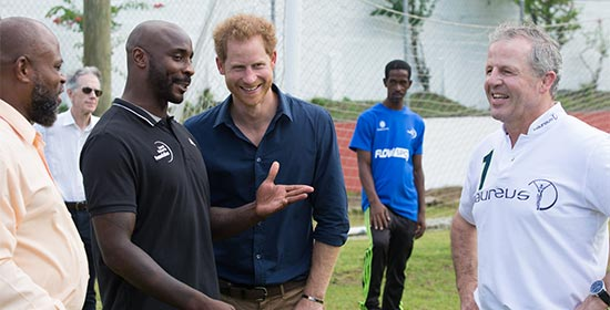 Jason Roberts, awarded an honorary doctorate from SGU in May 2016, meets with Prince Harry at Queens Park, Grenada.