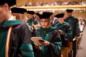 2017 Caribbean medical school graduates read a professional oath.