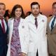 Cousins Jake and Emily Rienzo join their fathers and proud SGU graduates to accept their white coats at the Spring 2020 School of Medicine White Coat Ceremony