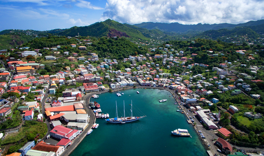 Ariel view of the island of Grenada with boats and blue skies